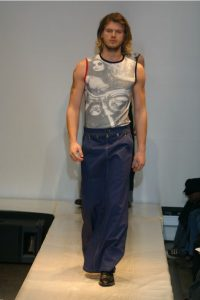 Male Runway Model in Muscle Shirt and Denim Maxi