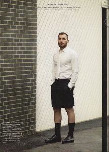 Professional Man Wearing Skirt, Shirt, and Tie